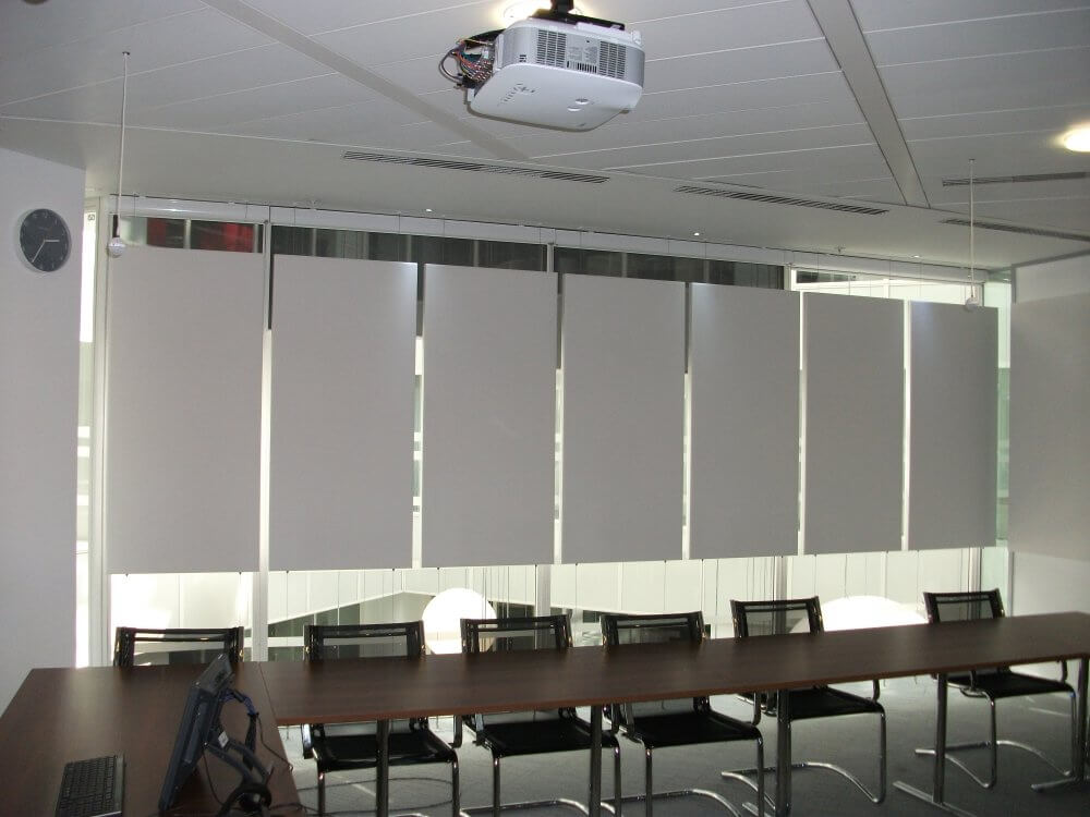 vertical suspended acoustic panels off wires - bespoke designed