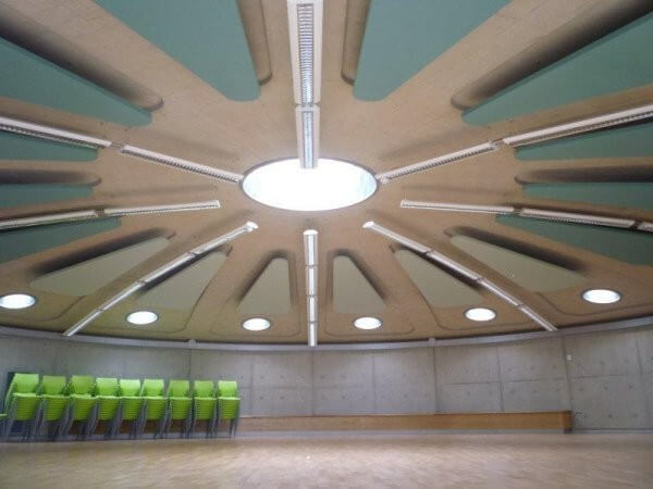 custom shaped acoustic suspended clouds in a school hall