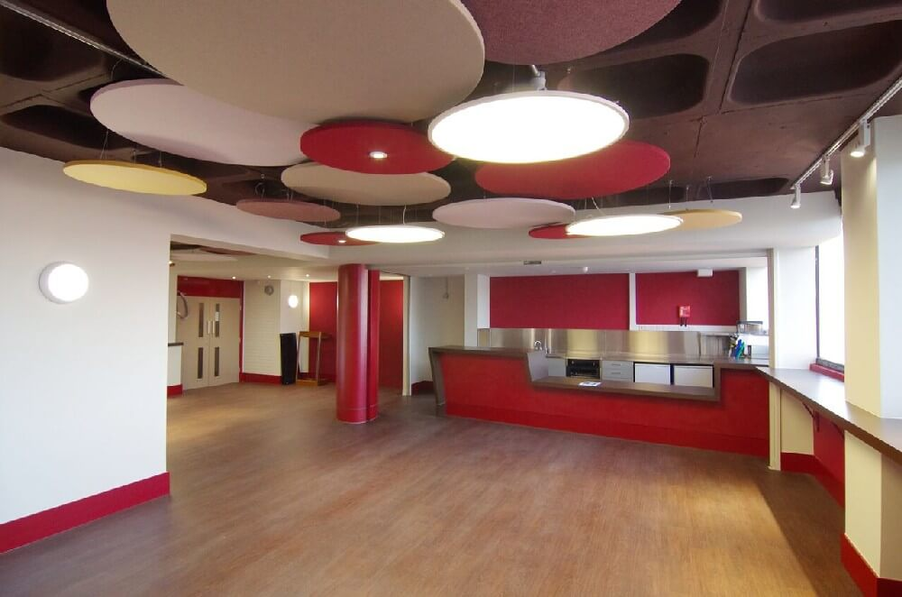 circular acoustic discs in a lobby installed