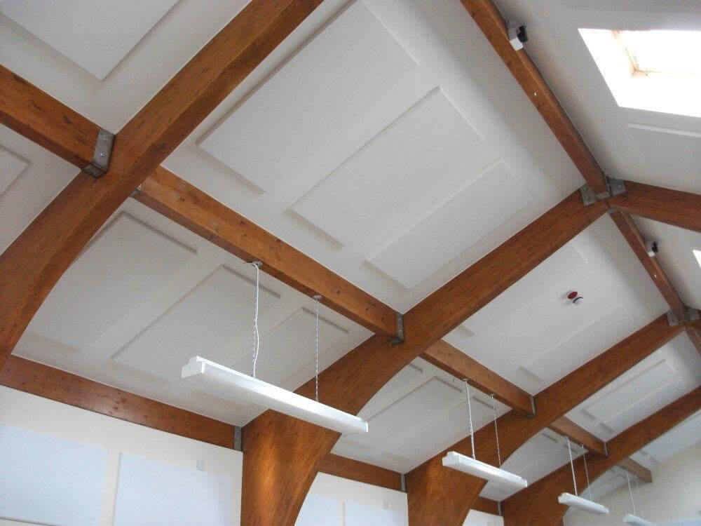 echotiles absorber panels on a ceiling and higher wall in a scout hut