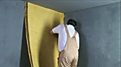 applying 2ftex plus to the wall using adhesive
