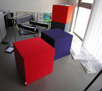 Coloured cubes freestanding in an office