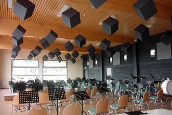 Grey Acoustic cubes suspended in a school classroom
