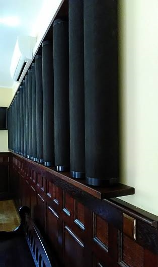 acoustic tubes installed against a wall