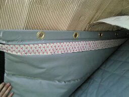 soundproof curtaining showing fixing detail with velcro and rings